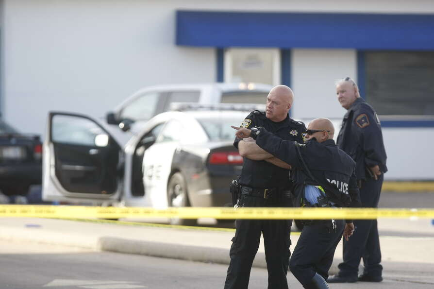 Police work the scene of the shooting of a Bellaire police officer Monday, Dec. 24, 2012, in southwe