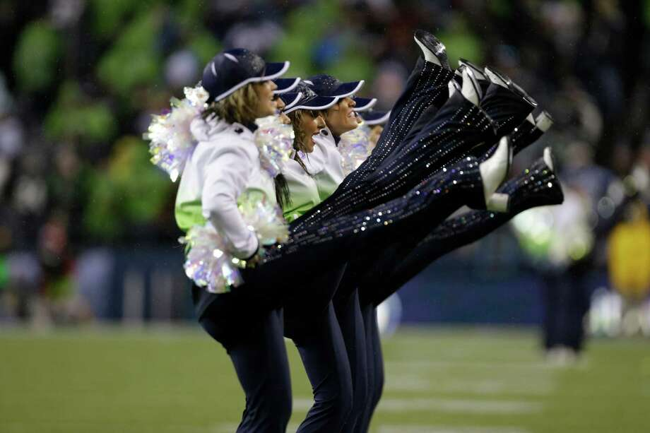 It rained, then rained and rained some more during the game. So who could blame the Sea Gals for ditching the Rockettes gear? We are surprised that they didn't have a yule log burning. Photo: Ap/getty