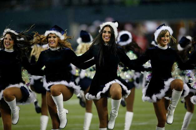 Seattle Seahawks Sea Gal cheerleaders perform in holiday themed attire in the first half of an NFL football game against the San Francisco 49ers, Sunday, Dec. 23, 2012, in Seattle. (AP Photo/John Froschauer) Photo: Ap/getty