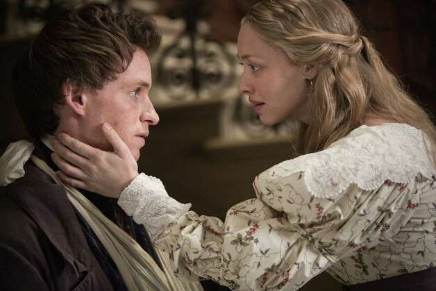 "This film image released by Universal Pictures shows Eddie Redmayne as Marius, left, and Amanda Seyfried as Cosette in a scene from ""Les Miserables."" (AP Photo/Universal Pictures, James Fisher) Photo: James Fisher, Associated Press / Universal Pictures"