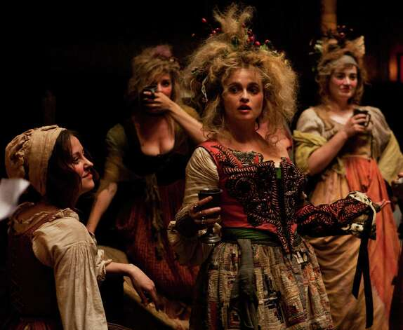 "This undated publicity photo provided by Universal Pictures shows, center, Helena Bonham Carter as Madame Thénardier in a scene from the film, ""Les Misérables."" (AP Photo/Universal Pictures/Laurie Sparham) Photo: Laurie Sparham, Associated Press / Universal Pictures"