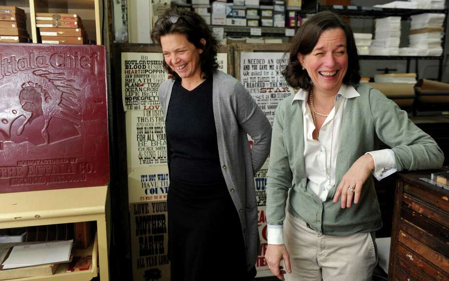 Madonna Badger, left, and her friend Kate Askew, right, talk in Askew's print shop, Yella Dog Press, in Little Rock, Arkansas, on Sunday, December 2, 2012. Badger has been living in Little Rock since she moved in with Askew following 2011's Christmas Day fire in Badger's Shippan home which killed her three daughters and parents. Photo: Lindsay Niegelberg / Stamford Advocate