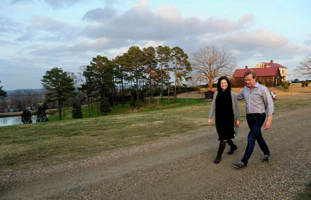 Madonna Badger walks with P. Allen Smith on his farm in Little Rock, Arkansas, on Sunday, December 2, 2012. Photo: Lindsay Niegelberg / Stamford Advocate