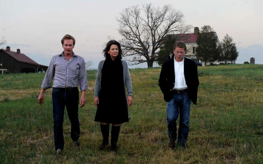 Madonna Badger walks on P. Allen Smith's farm in Little Rock, Arkansas, on Sunday, December 2, 2012. From left are Smith, Badger, and J. Harrison Kemp. Photo: Lindsay Niegelberg / Stamford Advocate