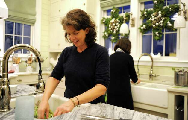 Madonna Badger helps prepare dinner with friends at P. Allen Smith's home in Little Rock, Arkansas, on Sunday, December 2, 2012. Photo: Lindsay Niegelberg / Stamford Advocate