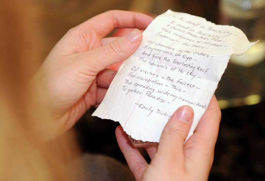 An Emily Dickinson poem given to Madonna Badger by a friend is read during a gathering of Badger's friends in her Little Rock, Arkansas, home on Sunday, December 2, 2012. Photo: Lindsay Niegelberg / Stamford Advocate