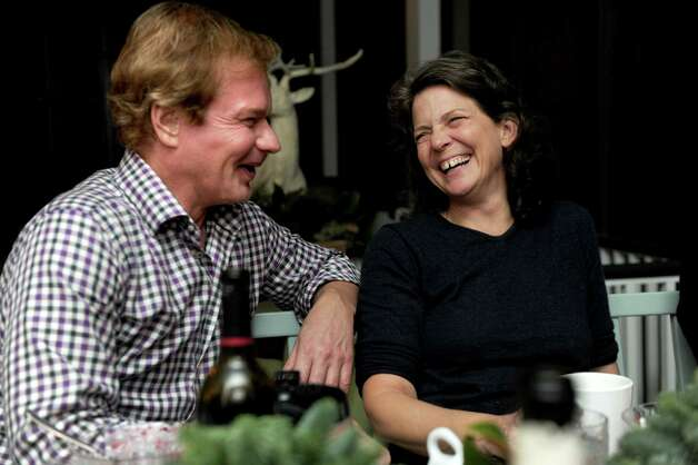 Madonna Badger and P. Allen Smith laugh during dinner in Smith's home in Little Rock, Arkansas, on Sunday, December 2, 2012. Photo: Lindsay Niegelberg / Stamford Advocate