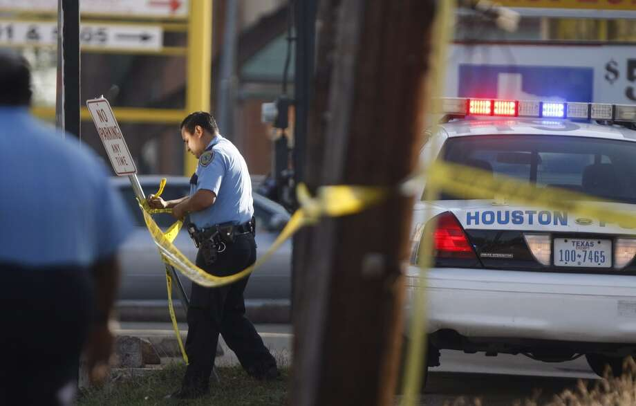 Police work the scene of the shooting of a Bellaire police officer Monday, Dec. 24, 2012, in southwest Houston. Photo: Johnny Hanson / Houston Chronicle
