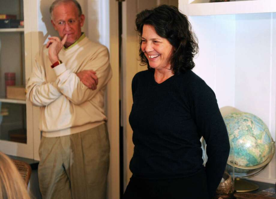 Madonna Badger talks with friends in the living room of the house she is renting in Little Rock, Arkansas, on December 2, 2012. Badger's three daughters and parents were killed in a Christmas day fire in her Shippan home in 2011. Photo: Lindsay Niegelberg / Stamford Advocate