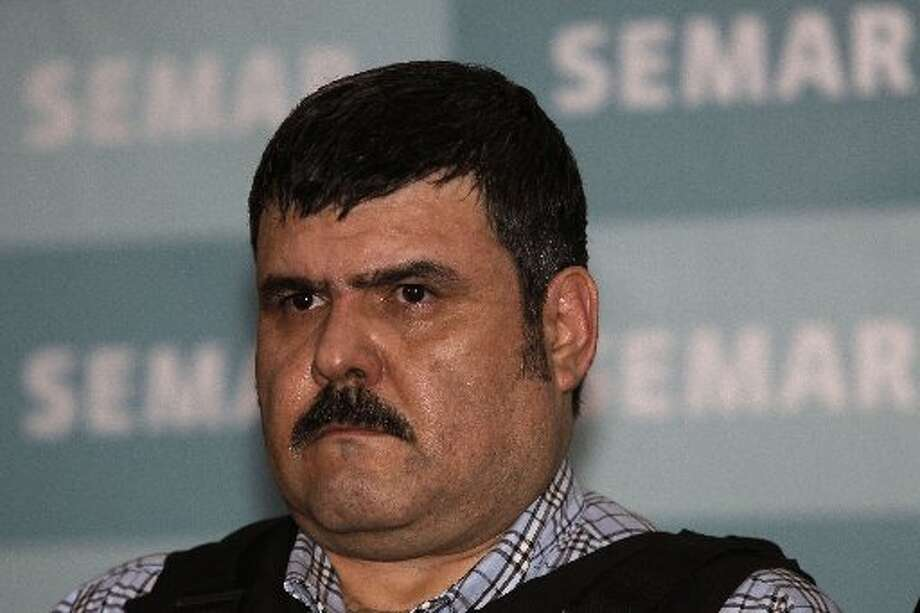 An alleged top leader of the Gulf drug cartel, Jorge Eduardo Costilla Sanchez, aka El Coss,  is shown during a media presentation at the Mexican Navy's Center for Advanced Naval Studies in Mexico City, Sept. 13, 2012. One of Mexico's most-wanted men, the 41-year-old is charged in the U.S. with drug-trafficking and threatening U.S. law enforcement officials. U.S. authorities offered $5 million for information leading to his arrest. (AP Photo/Dario Lopez-Mills)