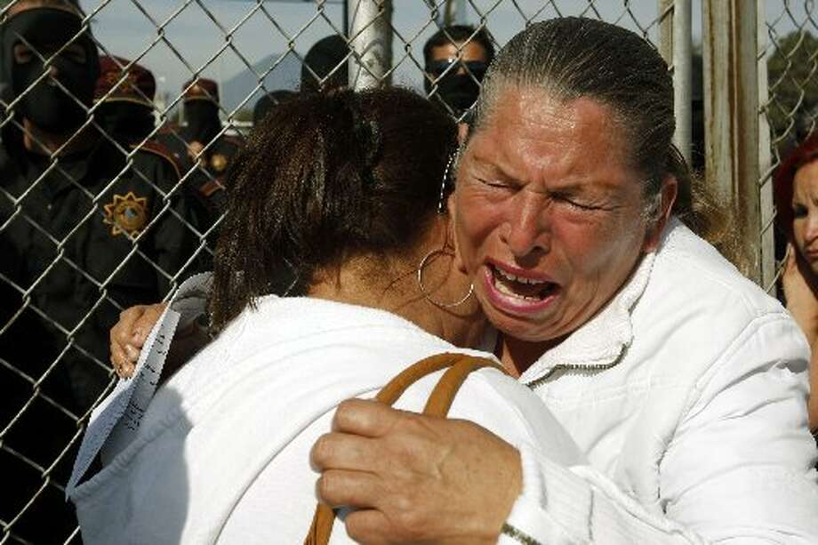 Relatives of inmates cry while waiting outside Apodaca prison, on February 19, 2012, near Monterrey, state of Nuevo Leon, Mexico. At least 38 inmates have been killed during a riot at a prison near the northern Mexican city of Monterrey, officials said. AFP PHOTO/Julio Cesar Aguilar (Photo credit should read Julio Cesar Aguilar/AFP/Getty Images)