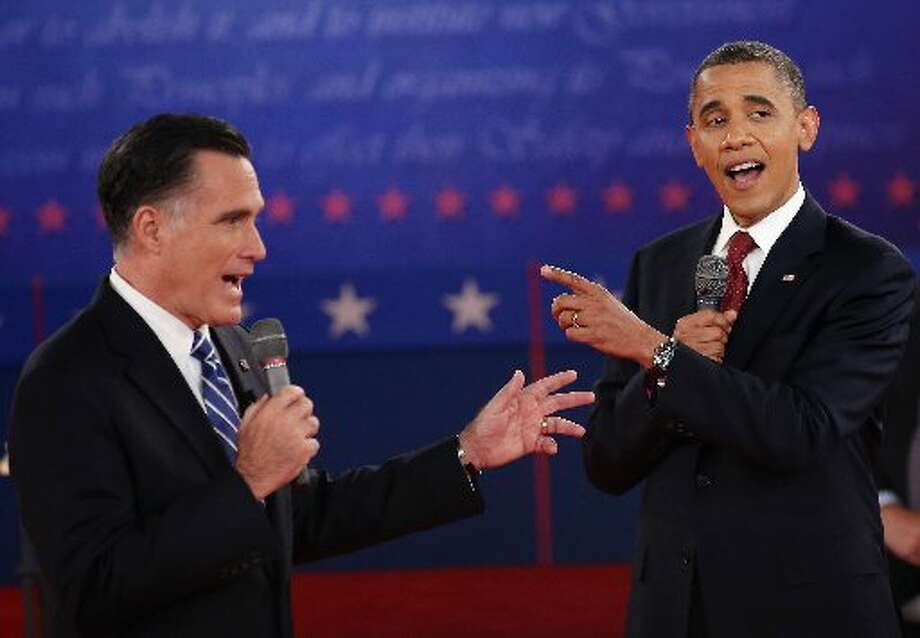HEMPSTEAD, NY - OCTOBER 16: (Best Of 2012) Republican presidential candidate Mitt Romney (L) and U.S. President Barack Obama talk over each other as they answer questions during a town hall style debate at Hofstra University October 16, 2012 in Hempstead, New York. During the second of three presidential debates, the candidates fielded questions from audience members on a wide variety of issues. (Photo by John Moore/Getty Images)