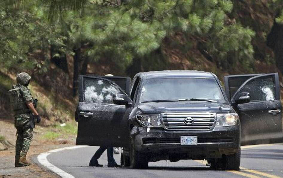 In this Aug. 24, 2012 file photo, Mexican military personnel check a vehicle in which two United Sta