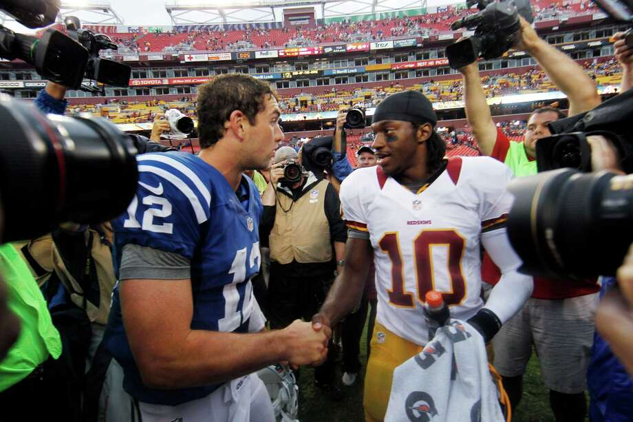 The future is nowSelected 1-2 in April's NFL draft, Andrew Luck, left, and Robert Griffin III are running neck-and-neck in the race for the Rookie of the Year award. Don't be surprised if the QBs are the top two candidates for next season's MVP award. Photo: Alex Brandon, Associated Press / AP