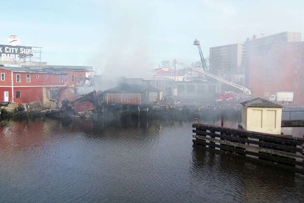 Bridgeport firefighters were at a stubborn fire on Knowlton Street all day on Monday. This was the scene from Congress Street, looking across the Pequonnock River. Photo: John Burgeson