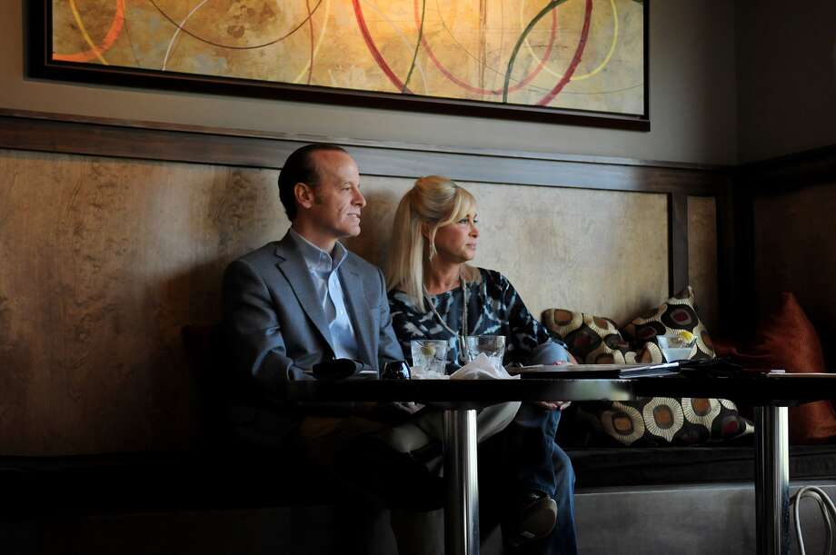 Paul and Kelly Loveless of The Woodlands check out the view from their table at  Crush in The Woodlands.  Freelance photo by Jerry Baker Paul and Kelly Loveless of The Woodlands check out the view from their table at  Crush in The Woodlands.  Freelance photo by Jerry Baker Photo: Jerry Baker, Freelance
