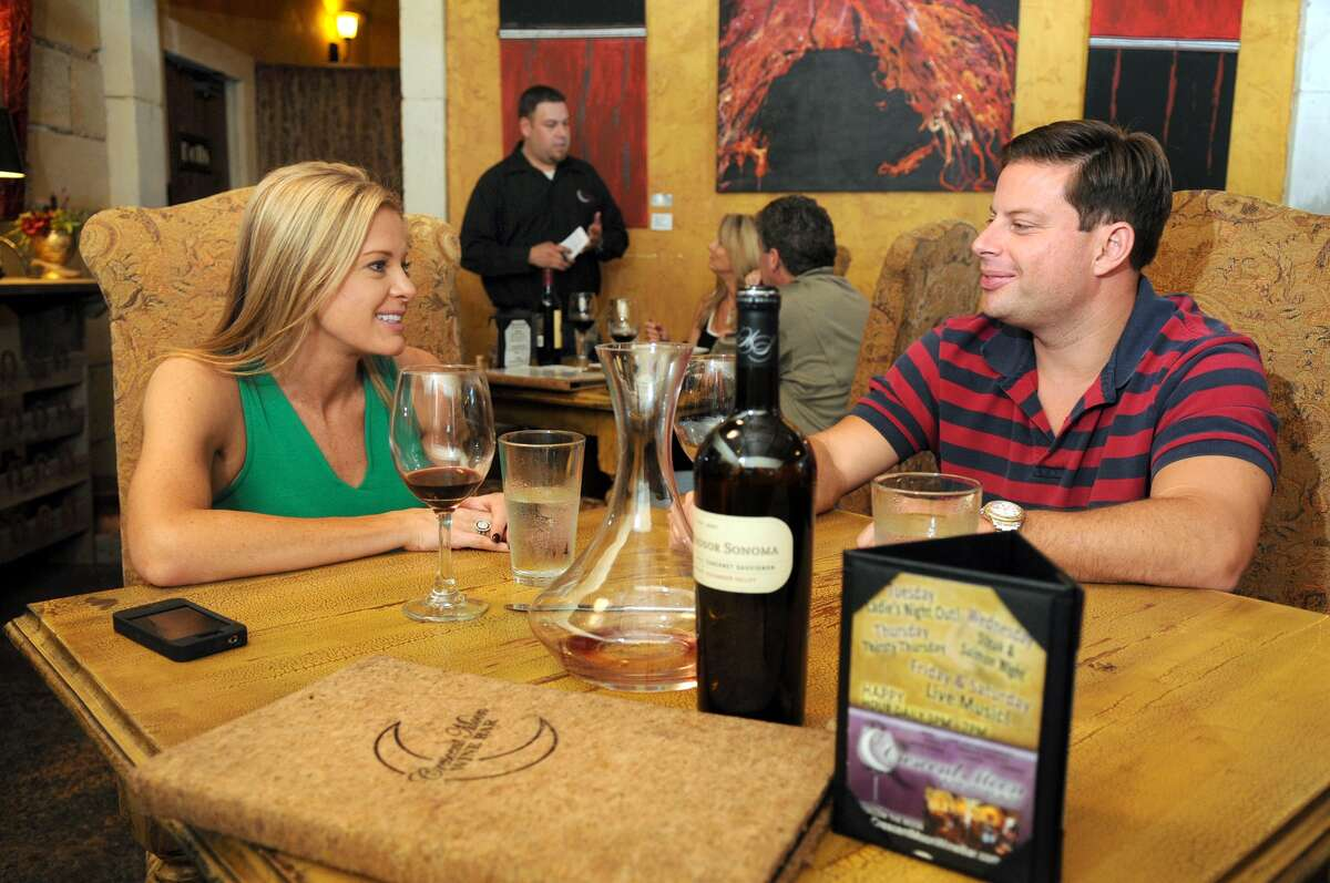 Kim and Robert Milliman share a bottle of wine at the Crescent Moon Wine Bar and Restaurant in Spring.