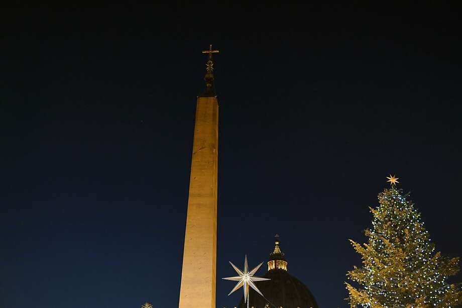 This picture taken on December 24, 2012 shows St Peter's Dome, the obelisc and the Christmas tree during the unveiling ceremony of the crib at the Vatican. Pope Benedict XVI will celebrate a late Christmas night holy mass at St. Peter's Basilica to mark the nativity of Jesus Christ. Photo: Vincenzo Pinto, AFP/Getty Images