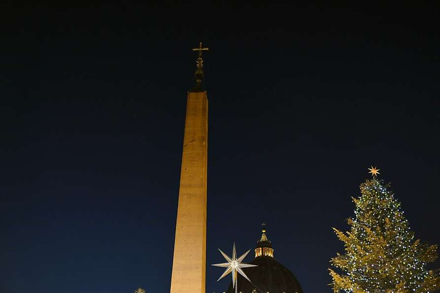 This picture taken on December 24, 2012 shows St Peter's Dome, the obelisc and the Christmas tree du