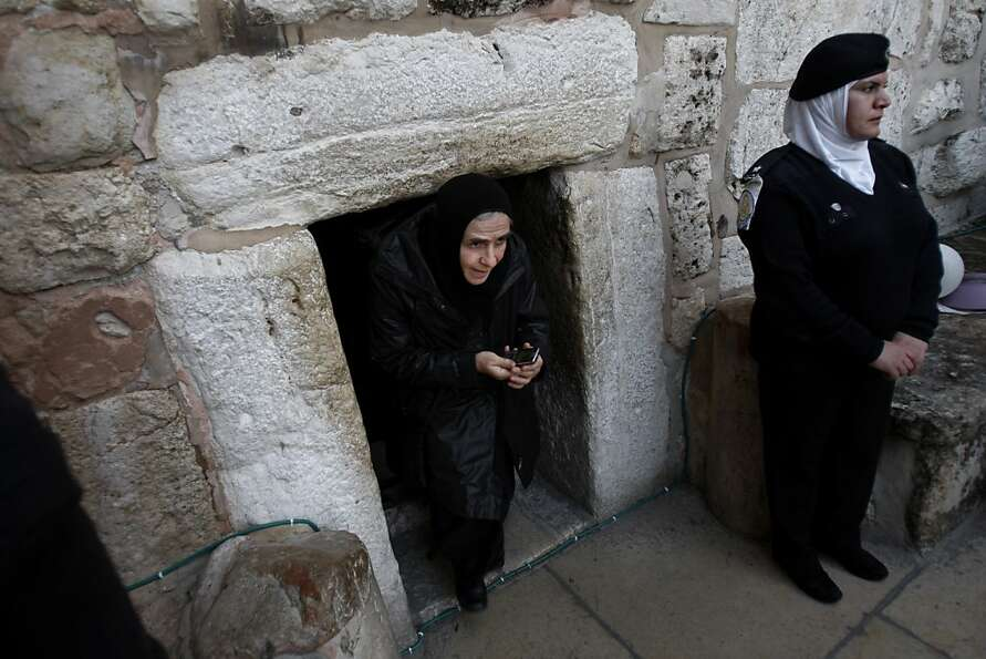 A Christian worshiper walks out of the Church of Nativity, traditionally believed by Christians to b