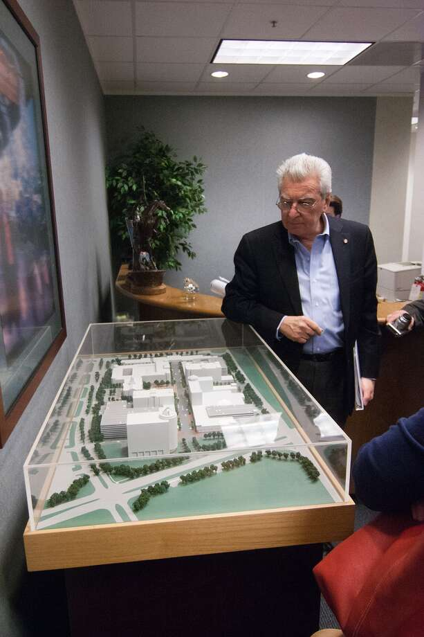 Ronald Altoon, a member of the Urban Land Institute award jury, checks out a model of Sugar Land Town Square before leaving to tour the real thing. Altoon is a trustee of the International Council of Shopping Centers.  Ronald Altoon, a member of the Urban Land Institute award jury, checks out a model of Sugar Land Town Square before leaving to tour the real thing. Altoon is a trustee of the International Council of Shopping Centers. Photo: R. Clayton McKee, Freelance / © R. Clayton McKee