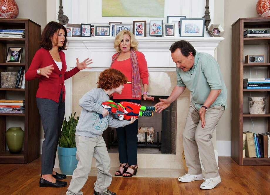 """Billy Crystal, right, and Bette Midler play grandparents baby-sitting Barker (Kyle Harrison Breitkopf) for his mother (Marisa Tomei, left) in """"Parental Guidance."""" Photo: 20th Century Fox / Twentieth Century Fox/Walden Med"""