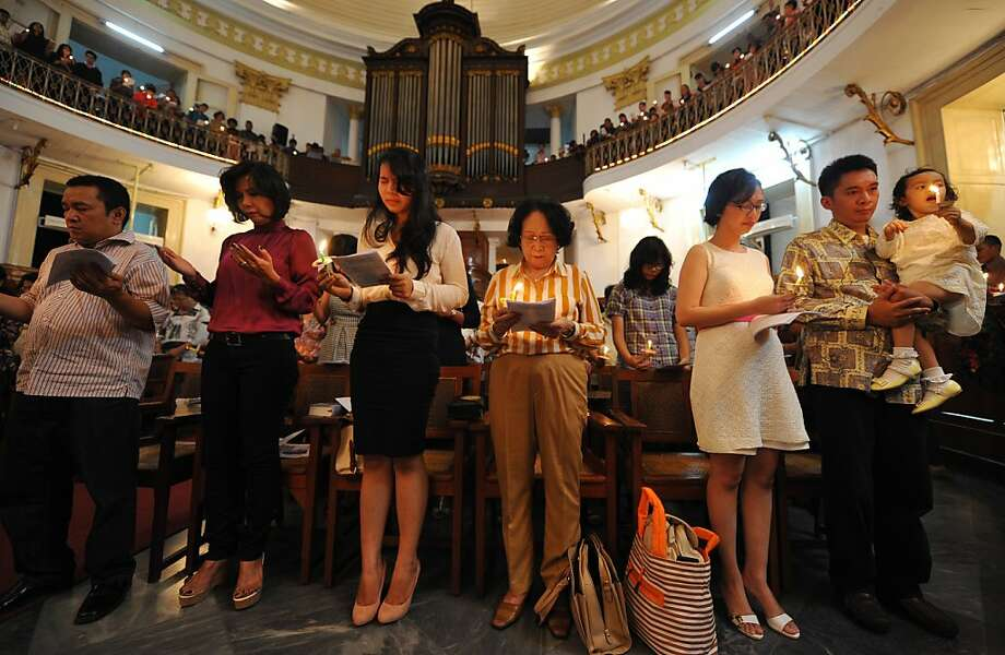 Christian worshippers pray during Christmas services in Jakarta on Christmas Eve, December 24, 2012. Christians in Indonesia, which comprise about ten percent of the world's largest Muslim-majority nation, celebrated Christmas. Photo: Adek Berry, AFP/Getty Images