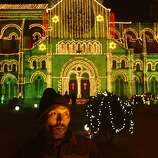 An electrician puts up illuminations at All Saints Cathedral on the eve of Christmas in Allahabad, India, Monday, Dec. 24, 2012. Although Christians comprise only two percent of the population Christmas is a national holiday and is observed across the country as an occasion to celebrate. (AP Photo/Rajesh Kumar Singh)
