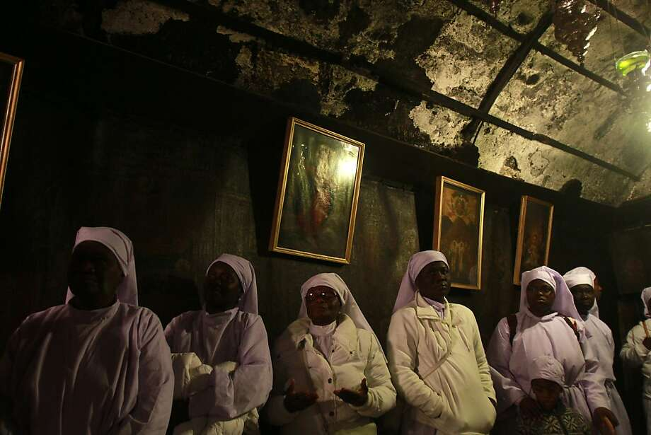 Nigerian Christian pilgrims pray inside the Grotto at the Church of the Nativity in the biblical West Bank city of Bethlehem, believed to be the birthplace of Jesus Christ, on December 24, 2012. Thousands of Palestinians and tourists were flocking to Bethlehem to mark Christmas at the site where many believe Jesus Christ was born. Photo: Musa Al-shaer, AFP/Getty Images