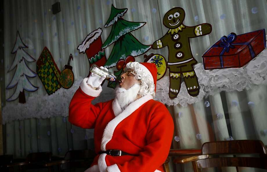A man dressed as Santa drinks cola as he waits to take part in a Christmas celebration in Mumbai, India, Monday, Dec. 24, 2012. Although Christians comprise only two percent of the population Christmas is a national holiday and is observed across the country as an occasion to celebrate. (AP Photo/Rafiq Maqbool) Photo: Rafiq Maqbool, Associated Press