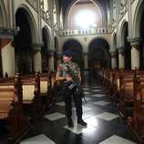 "An armed police officer stands guard inside a church during a security sweep ahead of Christmas eve services at the main cathedral in Jakarta, Indonesia, Monday, Dec. 24, 2012. Since the Bali bombings in 2002, the world's largest Muslim country has been battling terrorists who recently operate in small groups and have targeted security forces and local ""infidels"" instead of Westerners. (AP Photo/Tatan Syuflana)"