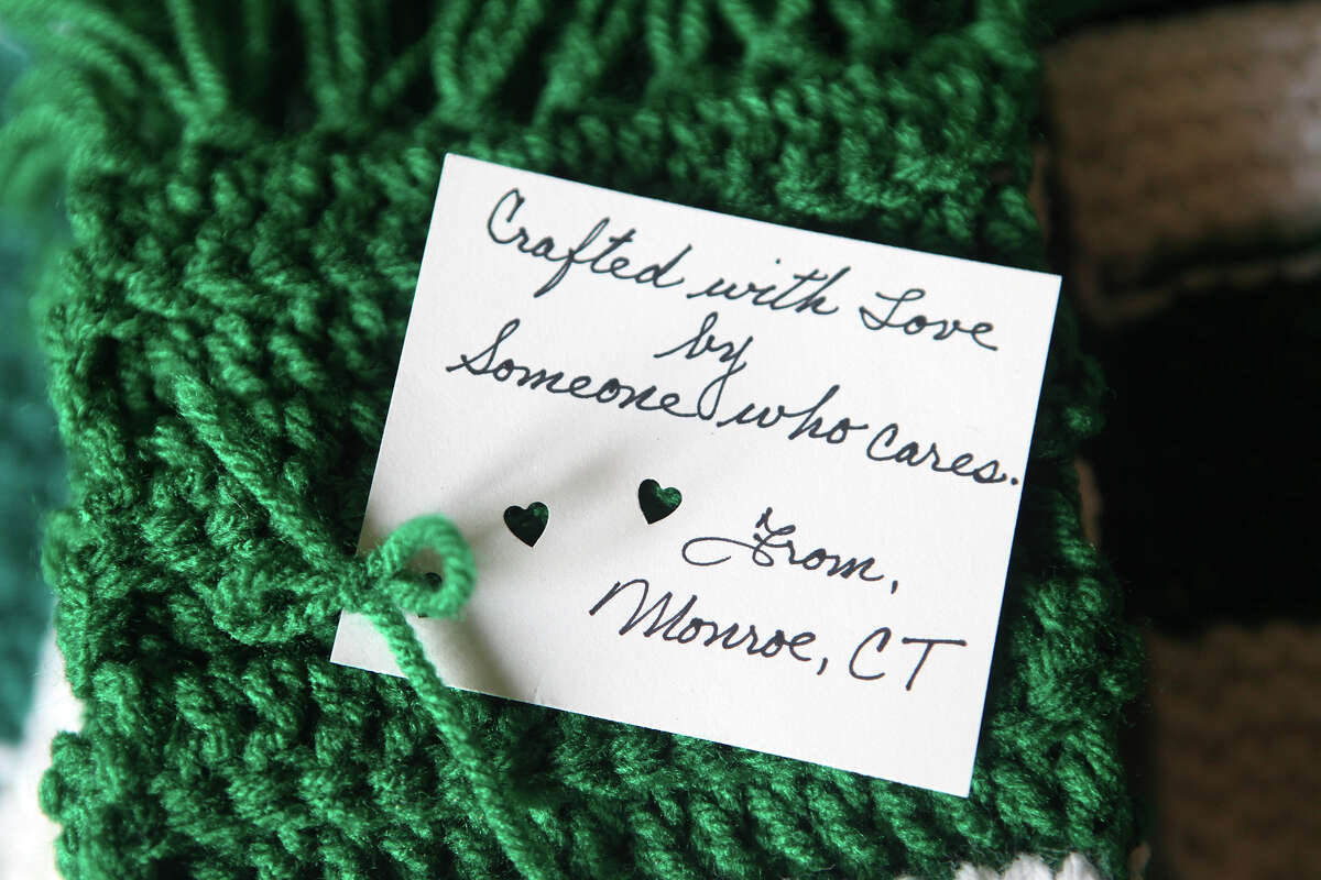 A note and detail of a scarf that is part of an effort by Jeanne Malgiogo, a Trumbull school teacher, and volunteers from all over, to provide children of Sandy Hook with scarves on Monday, December 24, 2012.