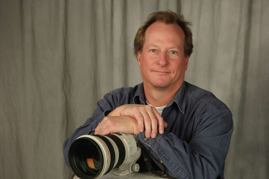 John Davenport, photojournalist, photographed Thursday Dec. 16, 2010. Photo: HELEN L. MONTOYA, SAN ANTONIO EXPRESS-NEWS / hmontoya@express-news.net