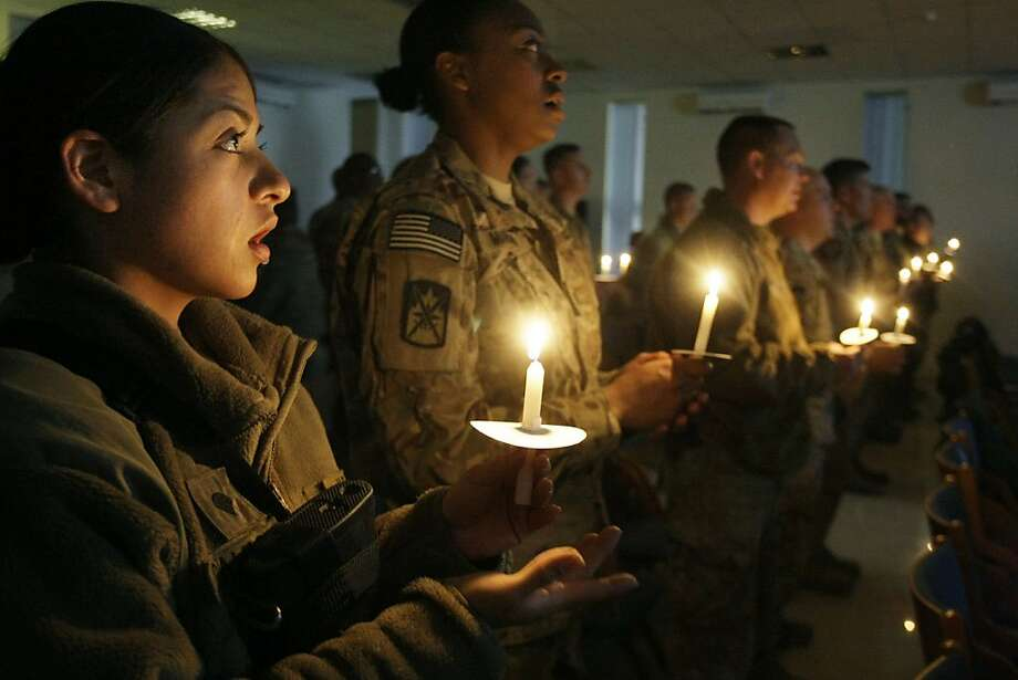 Specialist Gloria Camacho and fellow soldiers on Christmas Eve in Kabul. Photo: Musadeq Sadeq, Associated Press
