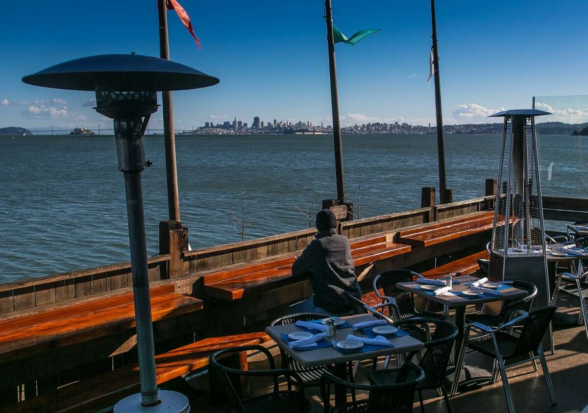 Now the Trident is back, with that original ceiling, dark wood-slatted walls, curved booths and a magical view of Oz, the San Francisco skyline. (Special to the Chronicle)