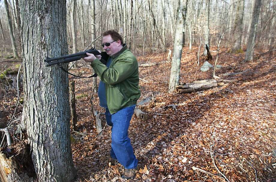 "Adam Palmer of Ansonia, Conn., says his shotgun is a ""tool"" that allows him to be prepared for catastrophic events. Photo: Cody Duty, Cody Duty/Hearst Newspapers"