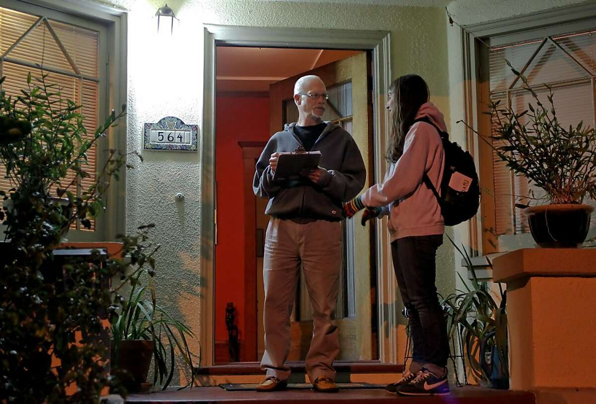 Field director for the evolve group Erica Bleicher (right) gains support from home owner Dennis Hill while canvasing in Oakland, Calif., on Thursday Dec. 13, 2012. The evolve group is making an effort to repeal parts of Proposition 13 to free up money for education in California. Members of the group are going door to door to gain support monetary funds to bolster their