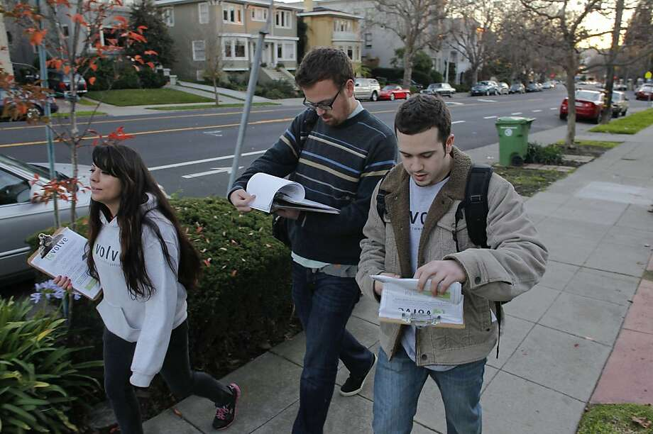 "Members of the evolve group, (l to r)  Felicia Colon, Sam Kippen and Ian Fregosi begin the evening canvasing in Oakland, Calif., on Thursday Dec. 13, 2012. The evolve group is making an effort to repeal parts of Proposition 13 to free up money for education in California. Members of the group are going door to door to gain support  to bolster their ""Close the Corporate Loophole"" campaign. Photo: Michael Macor, The Chronicle"