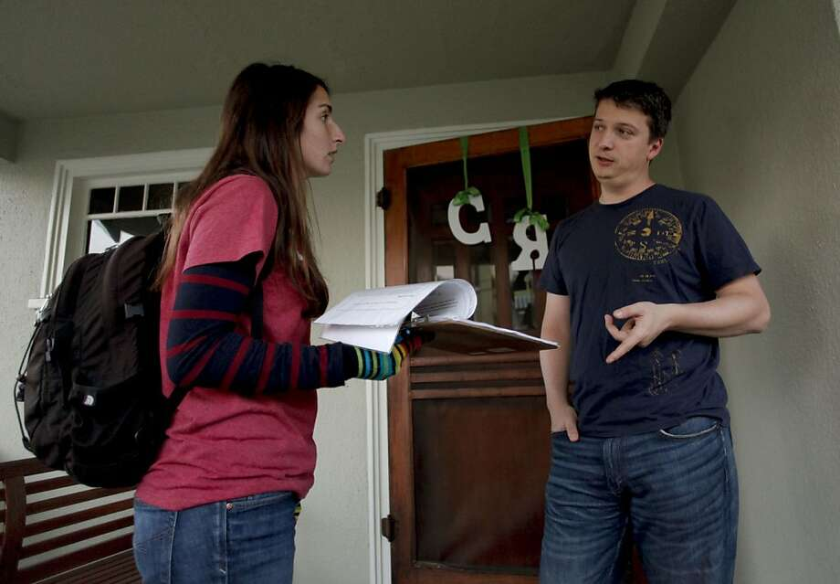 "The group's field director, Erica Bleicher talks with homeowner Radu Damian in Oakland, Calif., on Thursday Dec. 13, 2012. The evolve group is making an effort to repeal parts of Proposition 13 to free up money for education in California. Members of the group are going door to door to gain support to bolster their "" Close the Corporate Loophole"" campaign. Photo: Michael Macor, The Chronicle"