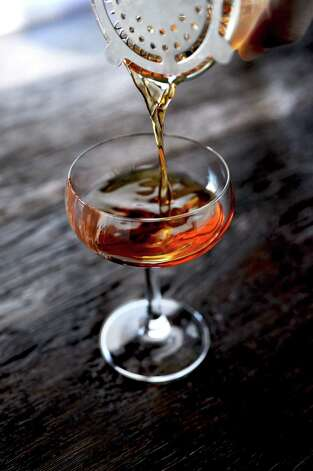 Nocciola is one of the holiday cocktails featured at Coppa. It is a hazelnut-flavored drink made with Frangelico. Nutella, a hazelnut chocolate spread, is swiped on the glass. Photo: Debora Smail / Debora Smail