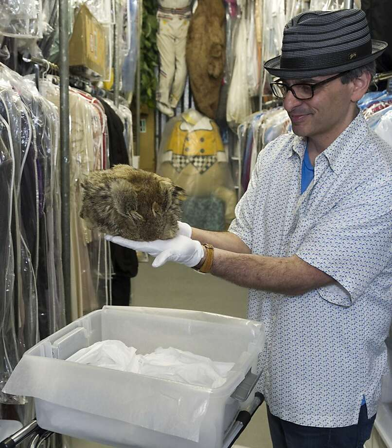 """In this Friday, Nov. 30, 2012 photo, James Comisar shows Fess Parker's """"Daniel Boone"""" coonskin hat worn in the late 1960s television show. The item is part of his television memorabilia collection in a temperature- and humidity-controlled warehouse in Los Angeles. (AP Photo/Damian Dovarganes) Photo: Damian Dovarganes, Associated Press"""