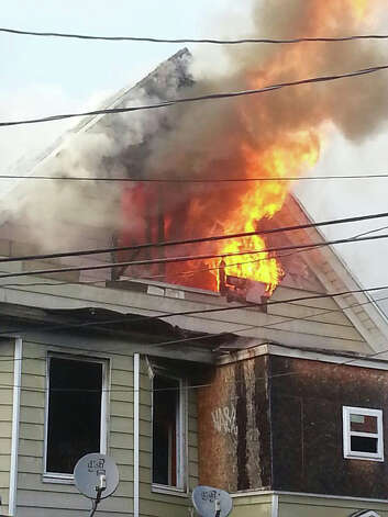 A fire burns at 6 Madison Terrace, a vacant house in the Hollow section of Bridgeport, Conn. on Dec. 24, 2012. Photo contributed by Steve Krauchick/DoingItLocal.com Photo: Contributed Photo