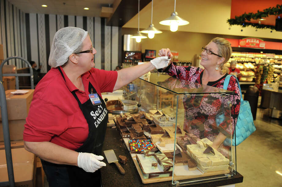 See's Candies Shop associate Judith Andersen offers an M&M Fudge sample to Sylvia Lanz, of the Heights. Photo: Jerry Baker, For The Chronicle / Freelance