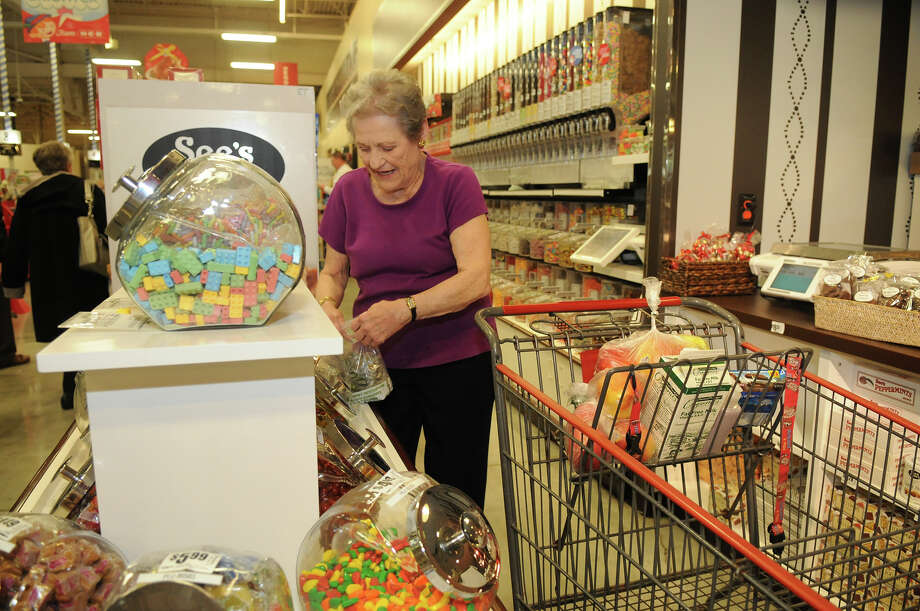 Ruth Pales buys candy for the reception desk at The Village in The Woodlands where she is a resident during her visit to the See's Candies shop at H-E-B Woodlands Market. Photo: Jerry Baker, For The Chronicle / Freelance