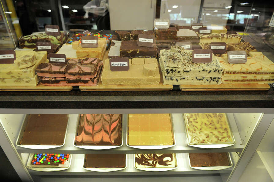 An assortment of fudges fill the showcase at the See's Candy Shop at the H-E-B  Woodlands Market.