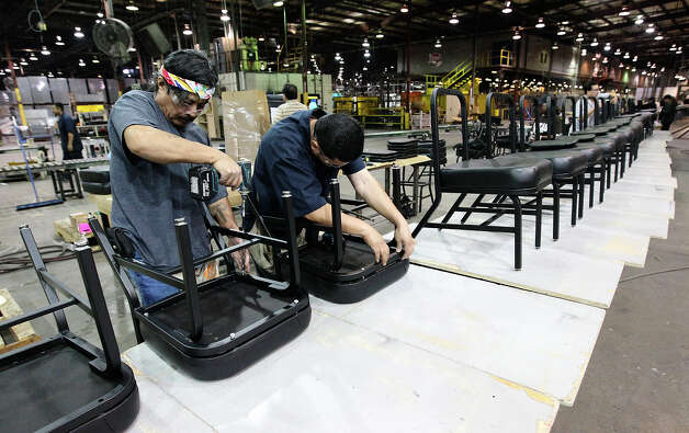 Workers put together metal chairs at KLN Steel Products on Thursday, Dec. 13, 2012. KLN marked their sixth-month anniversary since it was acquired from bankruptcy by Dallas-based Avteq Inc. The company makes furniture for military barracks and college dorms. Photo: Kin Man Hui, San Antonio Express-News / © 2012 San Antonio Express-News