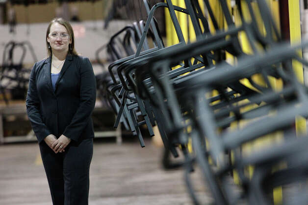 KLN Steel Products President Kelly O'Donnell stands near a conveyer carrying frames for metal chairs on Thursday, Dec. 13, 2012. KLN marked their sixth-month anniversary since it was acquired from bankruptcy by Dallas-based Avteq Inc. The company makes furniture for military barracks and college dorms. Photo: Kin Man Hui, San Antonio Express-News / © 2012 San Antonio Express-News
