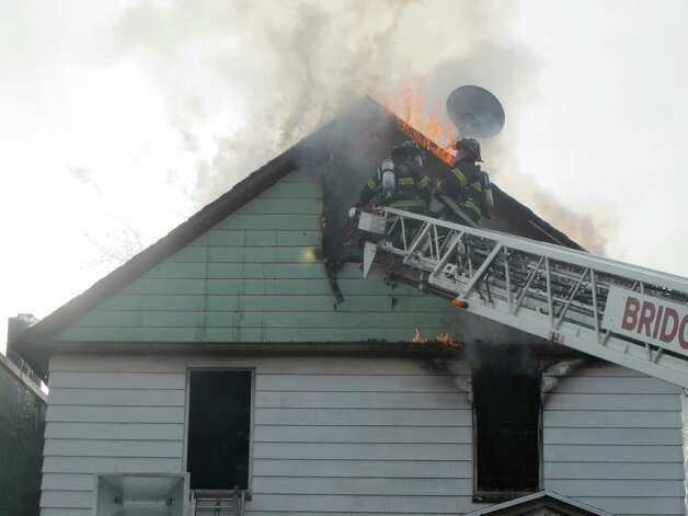 Bridgeport, Conn. firefighters battle a fire at Frank and Center street on Dec. 24, 2012. Photo: Tom Cleary