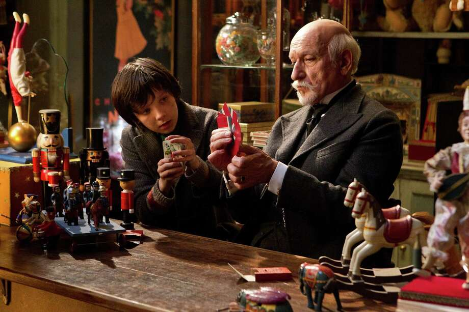 "In this film image released by Paramount Pictures, Asa Butterfield portrays Hugo Cabret, left, and Ben Kingsley portrays Georges Melies in a scene from the Oscar-nominated ""Hugo."" The leader with 11 nominations, ""Hugo"" was made by Martin Scorsese, arguably Hollywood s biggest cheerleader for the rediscovery and preservation of early films. (AP Photo/Paramount Pictures, Jaap Buitendijk Photo: AP Photo / © 2011 GK Films.  All Rights Reserved."