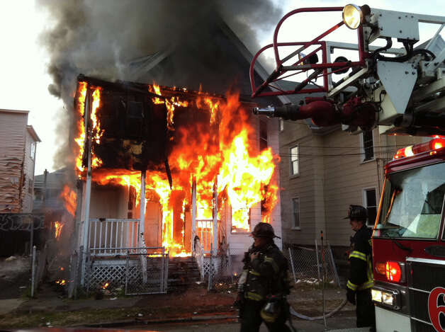 Fire burns at 367 Olive St. in Bridgeport, Conn. on Monday, Dec. 24, 2012. Photo: Ned Gerard